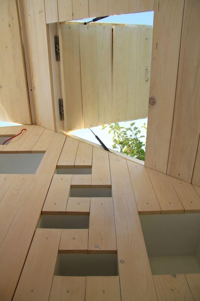 Integrated-Storage-and-Shelf-Ladder-in-Seelenkiste-Spirit-Shelter-682x1024