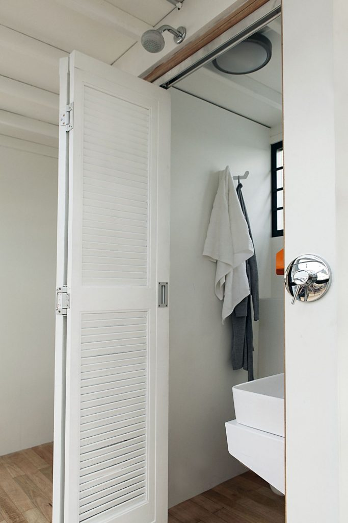 Pod-iDLADLA-bathroom-door-photographed-by-Brett-Rubin