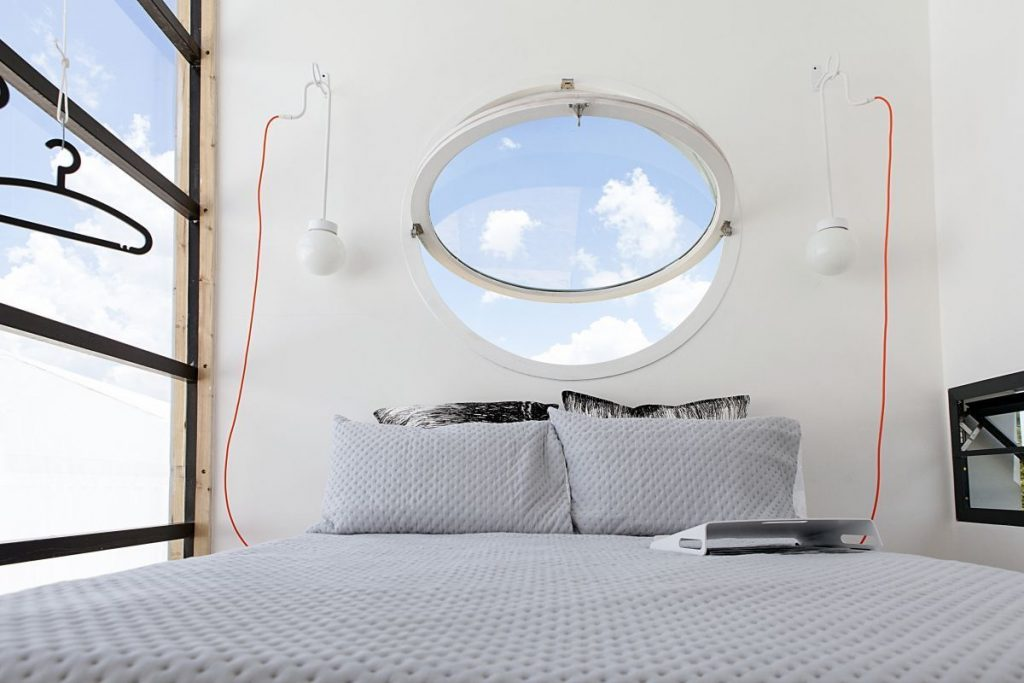 Pod-iDLADLA-mezzanine-bedroom-photographed-by-Brett-Rubin